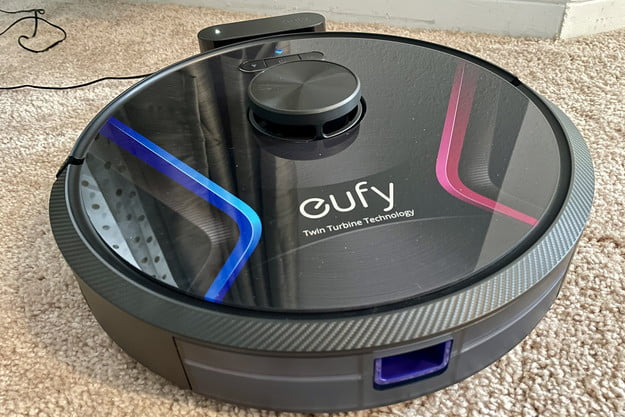 The RoboVac X8 docked on its charger.